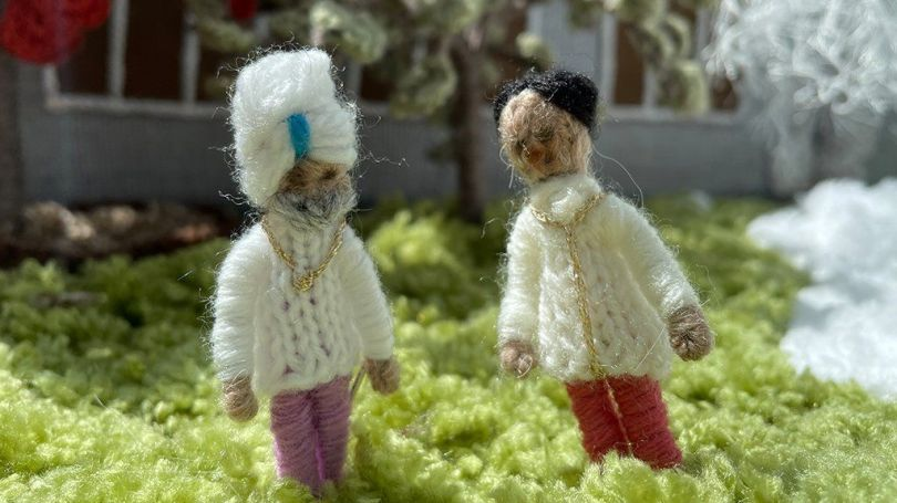 Two knitted figures.