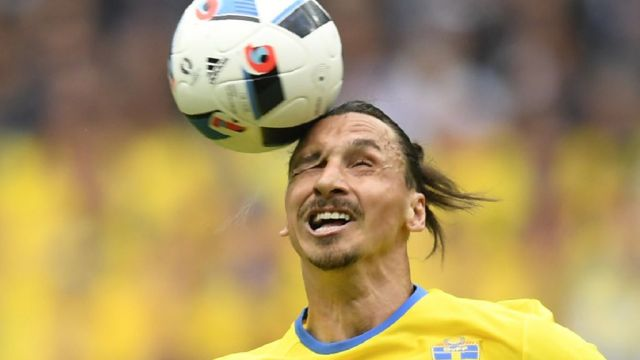 Image result for a footballer heading the football