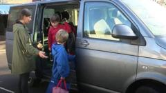 Children getting out of car