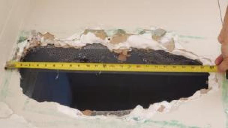 The 22in (55cm) wide hole the murder suspects cut and crawled through at the jail in Monterey County