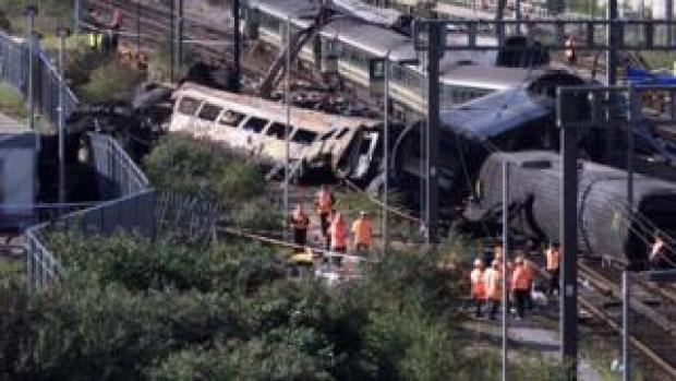 Investigators inspect the wreck of the two mainline trains that collided on 5 October 1999 at the peak rush hour near London's Paddington station