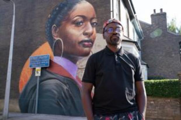 Dreph with EastEnders mural