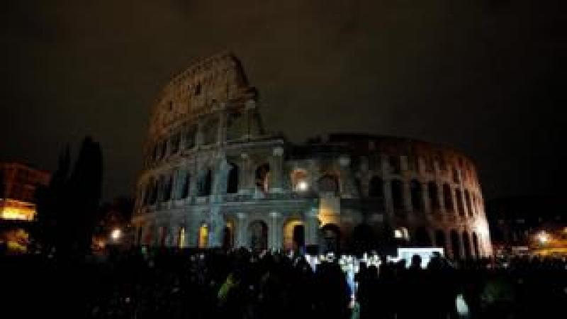 A picture taken on March 24, 2018 shows the ancient Colosseum during the Earth Hour initiative in Rome.