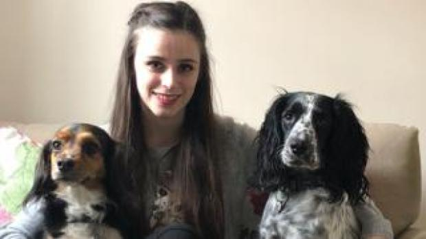 Tia Tuck with dogs, Biscuit and Domino