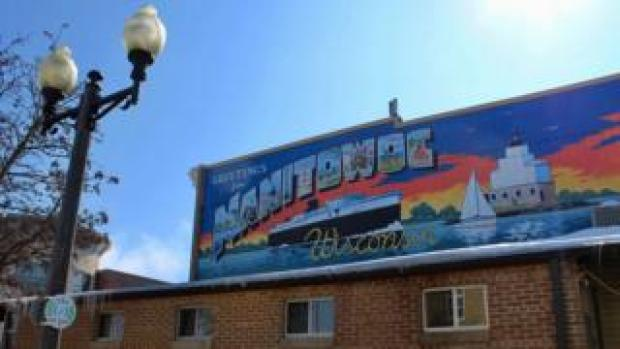A colourful mural welcomes people to the Manitowoc