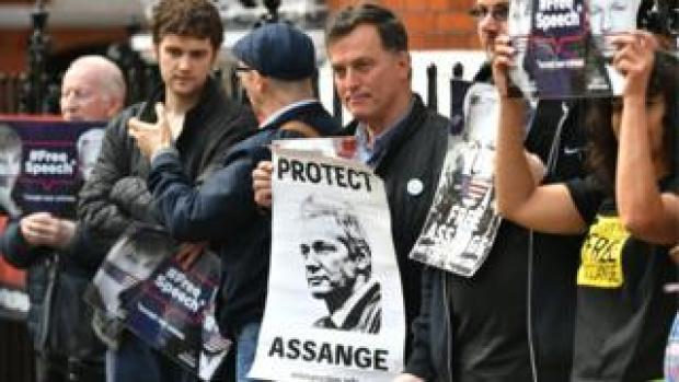 Protestors gather outside Ecuador's embassy in London