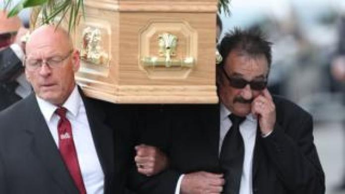 Paul Elliott carries the coffin of his brother Barry