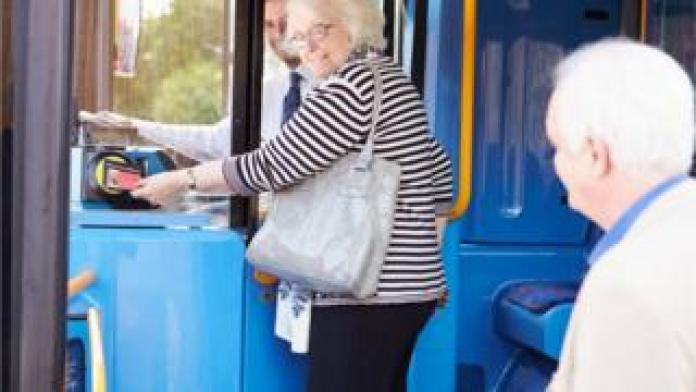 Pensioner getting on bus