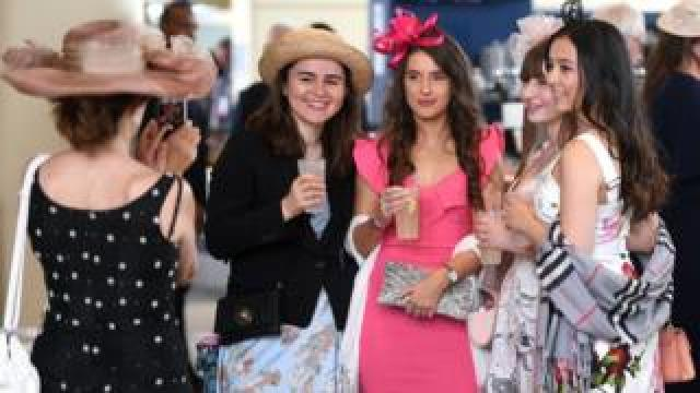 Racegoers in the Queen Anne Enclosure on day 1 of Royal Ascot at Ascot Racecourse