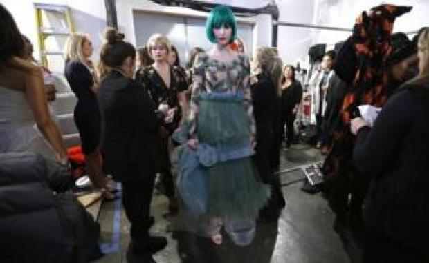 Models prepare backstage