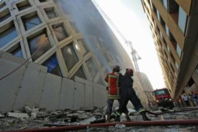Firefighters douse the flames of a blaze at a landmark modern building in central Beirut, 15 September 2020.
