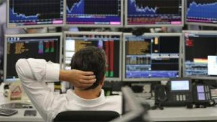 Trader watching monitor