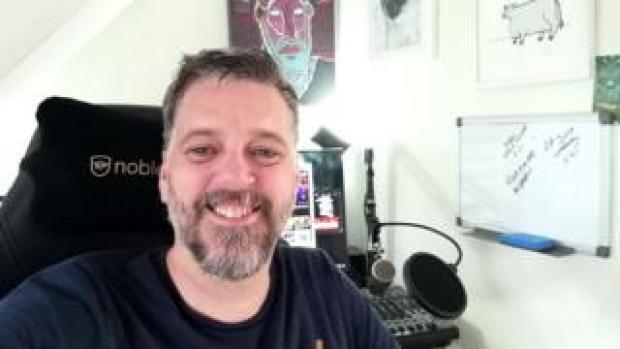 Iain Lee at his desk