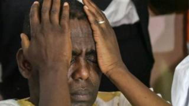 Biram Dah Abeid holding his hands to his head