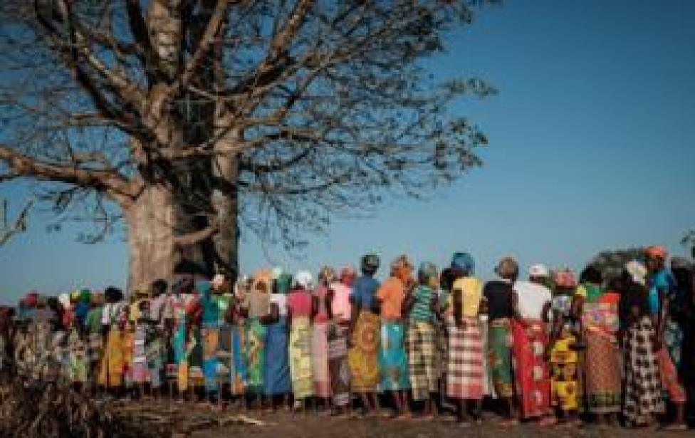 Women wait in a line to receive relief supplies in Estaquinha, Mozambique, on March 26, 2019.