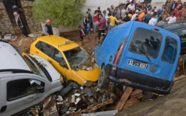 Cars are piled up in a street after being swept away by torrential rains in the city of Mohamedia near the Tunisian capital Tunis on October 18, 2018