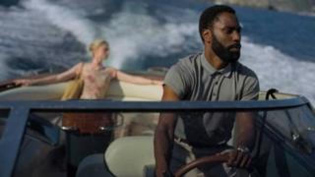 John David Washington with Elizabeth Debicki in Tenet