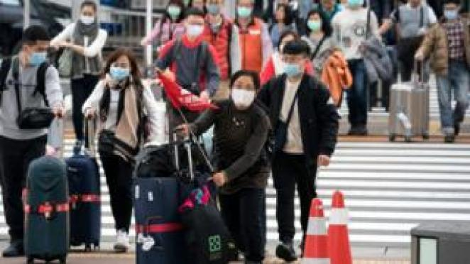 Chinese travellers wearing masks at the airport