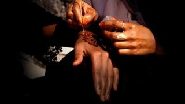 Henna painted on hand
