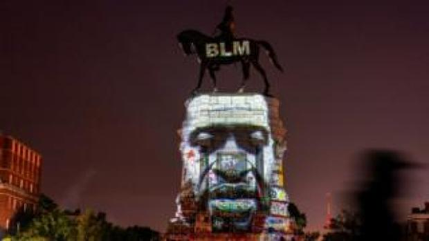 An image of George Floyd is projected on the statue of Confederate General Robert E. Lee in Richmond, Virginia, U.S. June 20, 2020