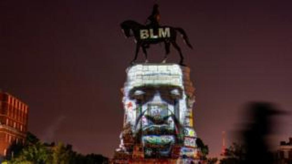 trump An image of George Floyd is projected on the statue of Confederate General Robert E. Lee in Richmond, Virginia, U.S. June 20, 2020