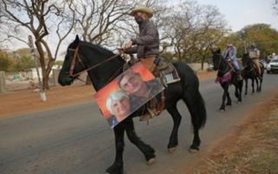 A farmer rides on his horse during a protest against farm attacks in Mookgophong on August 18, 2020.