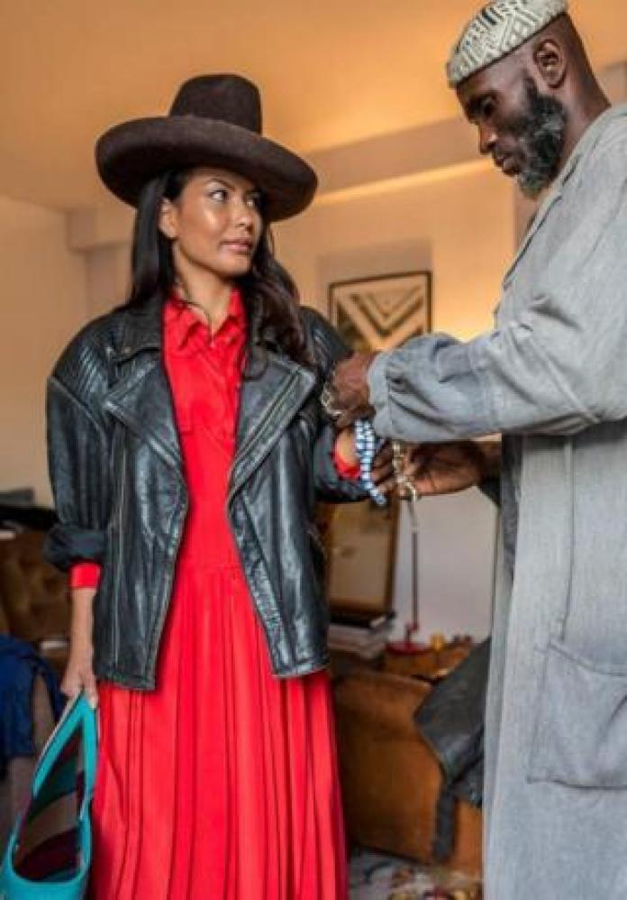 Amah styling a client in Paris