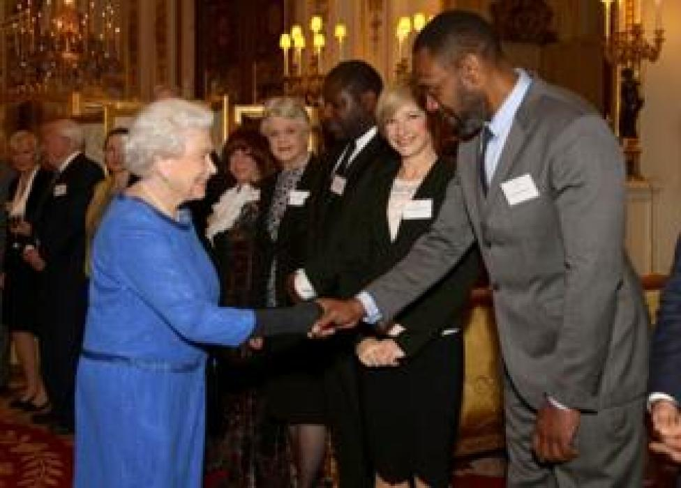 Queen Elizabeth II meets guests, including Lenny Henry, during the Dramatic Arts reception at Buckingham Palace on February 17, 2014 in London