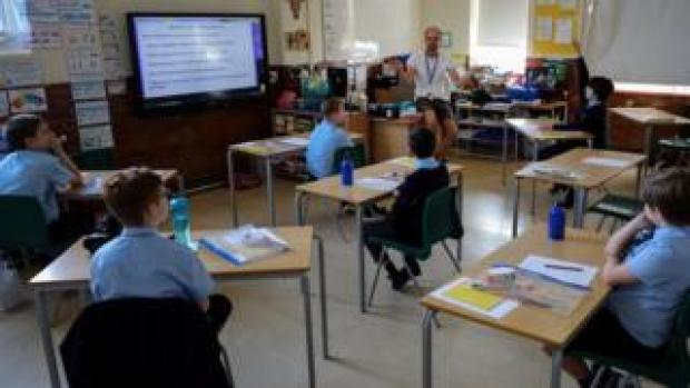 Pupils sit 2m apart in a classroom in west London