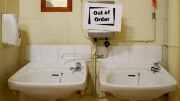 Out of order signs on toilet sinks. [SINGLE USE ONLY PIC]