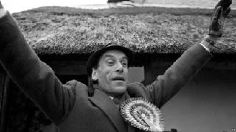 Jeremy Thorpe waves to the crowds outside his Cobbaton home before voting in the February 1974 election