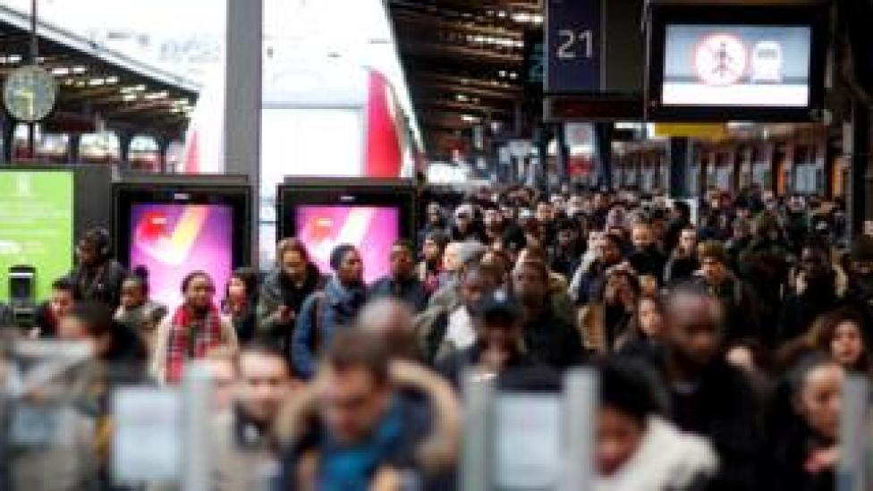 Commuters at France's Gare de l'Est train station during a strike by all unions of French SNCF and the Paris transport network (RATP) in Paris, 23 December 2019