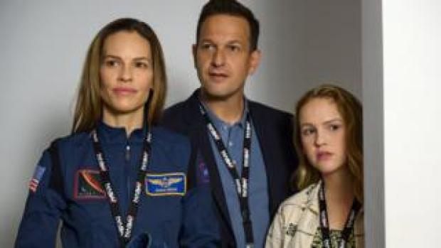 Hilary Swank, Josh Charles and Talitha Bateman in Away