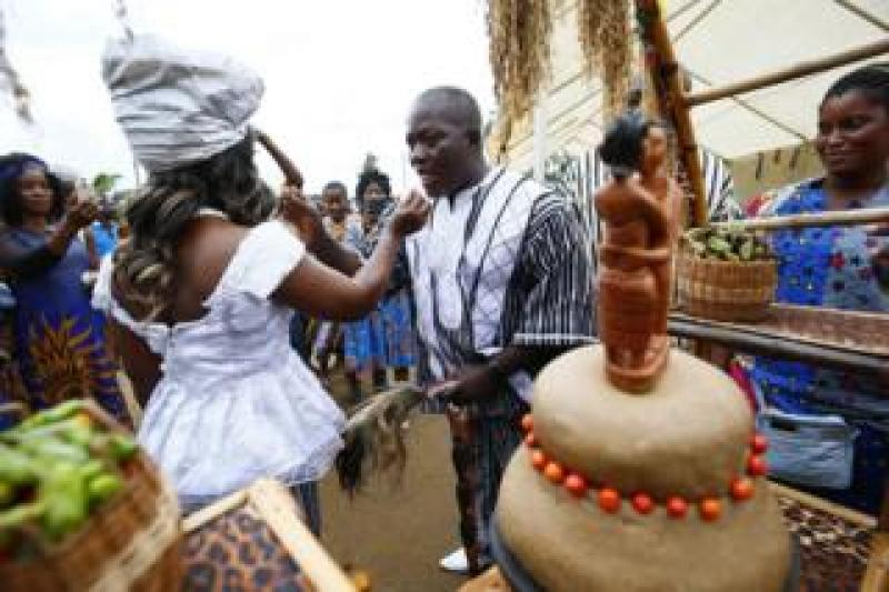 The groom, Sando G. Brownell (R) and the bride, Vester Sayee (L) share wedding cake, during their traditional wedding ceremony held in the Mount Barclay Community, a suburb of Monrovia, Liberia, 30 June 2018