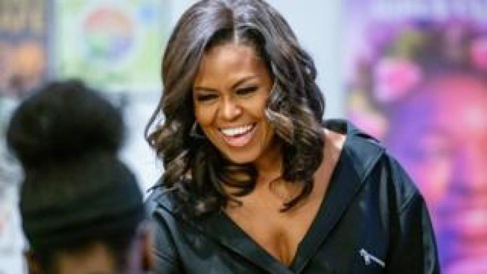 Michelle Obama smiles at a meet and greet with young girls