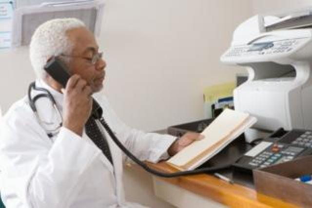 Doctor and fax machine