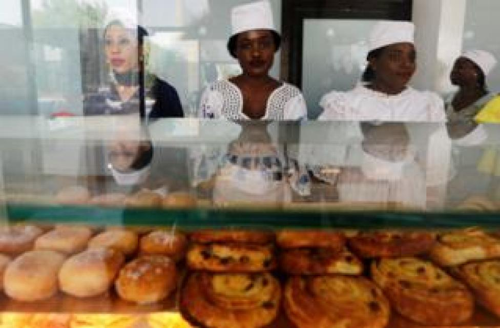 Vendors stand behind a display of pastries at O'Merveilles in Touba, Senegal, on 10 June.