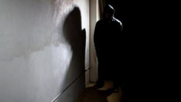 Intruder at door (posed by model)