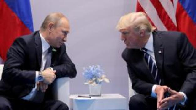 Russia's President Vladimir Putin talks to US President Donald Trump during their bilateral meeting at the G20 summit in Hamburg, Germany, July 7, 2017