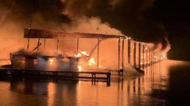 A row of boats engulfed in flames after catching fire at the marina in Scottsboro