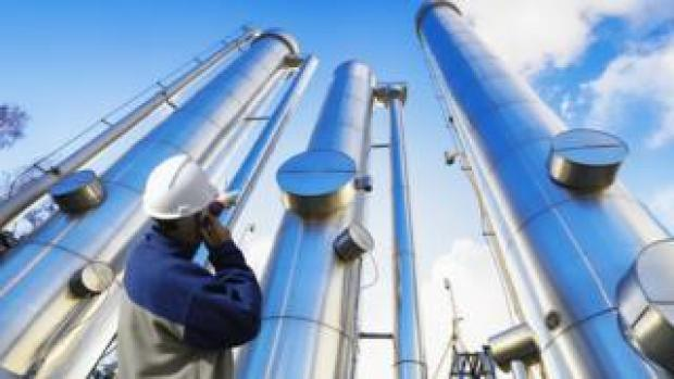 A worker by vertical pipelines