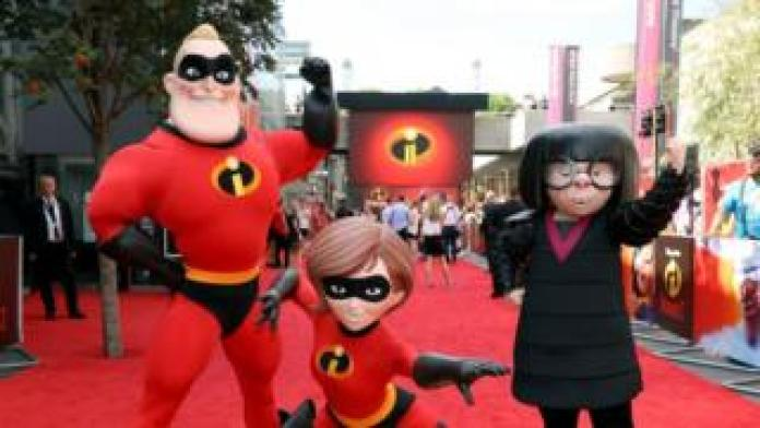 Mr Incredible, Elastigirl and Edna Mode pose at the Disney-Pixar British Premiere