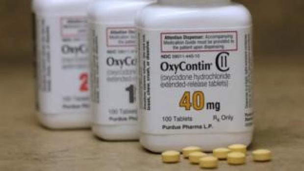 Bottles of prescription painkiller OxyContin pills, made by Purdue Pharma LP sit on a counter at a local pharmacy in Provo, Utah