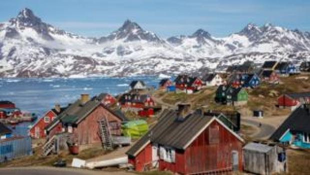 A file photo shows snow covered mountains rise above the harbour and town of Tasiilaq, Greenland, on June 15, 2018.