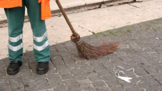 A street sweeper with a broom