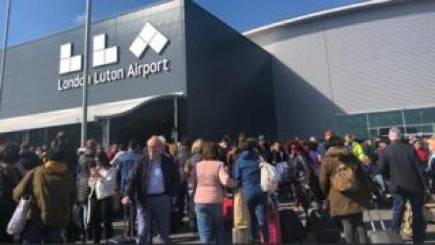 Passengers outside Luton airport