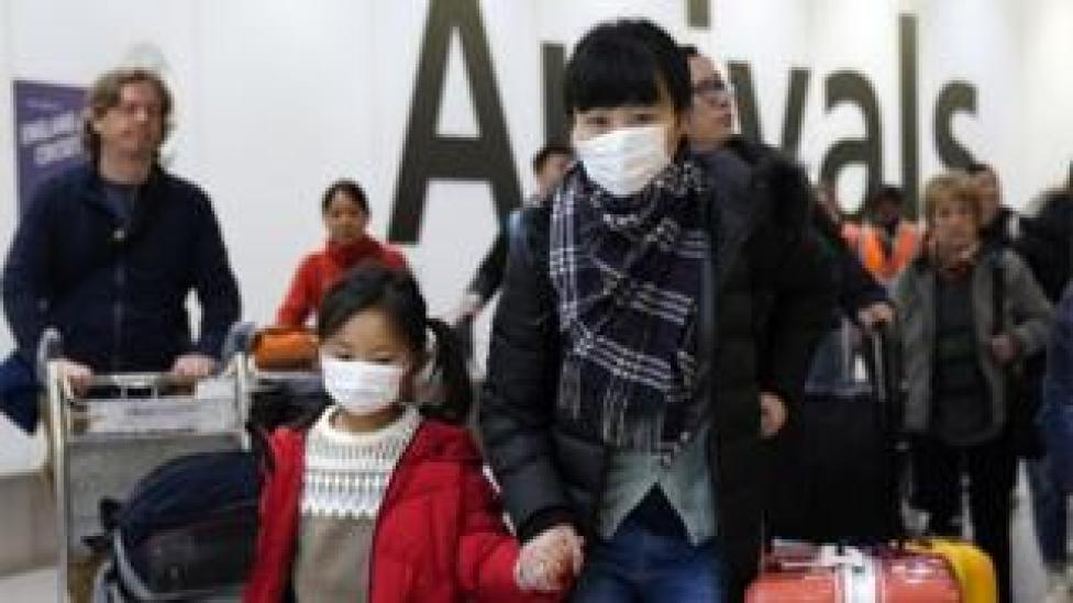 Passengers arrive wearing a mask at Terminal 4, Heathrow Airport, London, Britain, 22 January 2020.