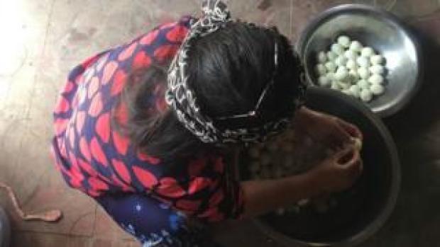 Girl peels eggs