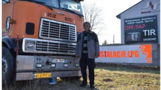 Fardin Kazemi in front of his broken down American International 9670 lorry