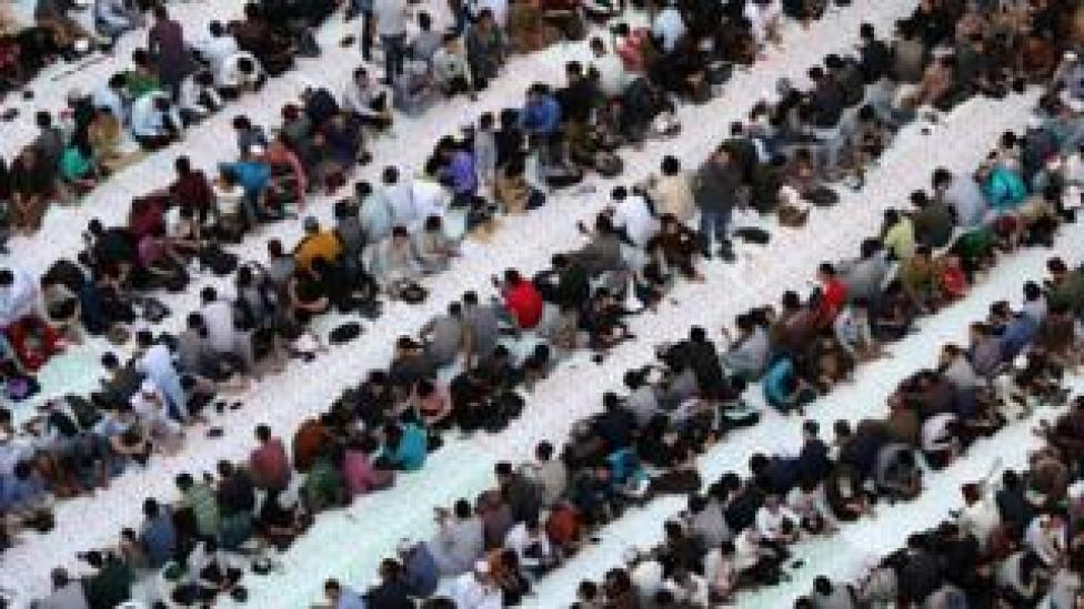 A large number of people sitting inside a mosque waiting to break the fast - Sunday 12 May